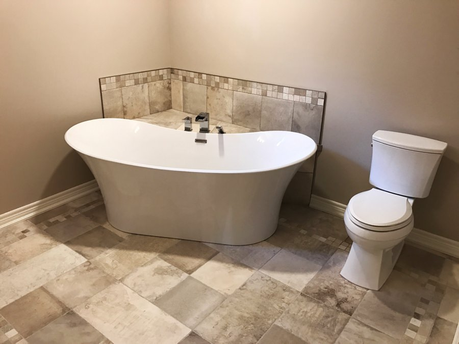 Bathroom reno with toilet and tub fixtures